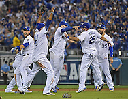 Oct 9, 2015; Kansas City, MO, USA; Kansas City Royals players celebrate after beating the Houston Astros in game five of the ALDS at Kauffman Stadium. Mandatory Credit: Peter G. Aiken-USA TODAY Sports