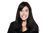 studio shot portrait on isolated white background of a Beautiful Woman stress fear toothy smile funny grimace