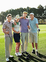 Group of young golfers posing on court