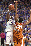 Kansas State forward Dramane Diarra (21) fires a shot over Lamarcus Aldridge (23) of Texas, during the second half at Bramlage Coliseum in Manhattan, Kansas, February 22, 2006.  The 7th ranked Longhorns held on for a 65-64 win over K-State.