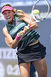 August 21, 2018 - New Haven, CT, USA - Anett Kontaveit of Estonia hits a return against Pauline Parmentier of France during their first-round match at the Connecticut Open Tennis Tournament in New Haven, Conn., on Tuesday, Aug. 21, 2018. Kontaveit advanced, 3-6, 6-2, 6-2. (Credit Image: © John Woike/TNS via ZUMA Wire)