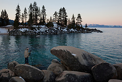 """Photographer at Sand Harbor"" - Photograph of photographer Tony Spiker (www.SpikerPhotography.com) photographing Lake Tahoe from Sand Harbor, Nevada."