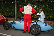 Mechanics, drivers and owners stand next to their period racing casr at the paddock leading up to the race track at the Goodwood Revival in Chichester, England   Friday, Sept. 9, 2016 The historic motor racing festival celebrates the mid-20th-century golden era of the racing circuit and recreates the atmosphere from the 1950s and 1960s.(Elizabeth Dalziel)