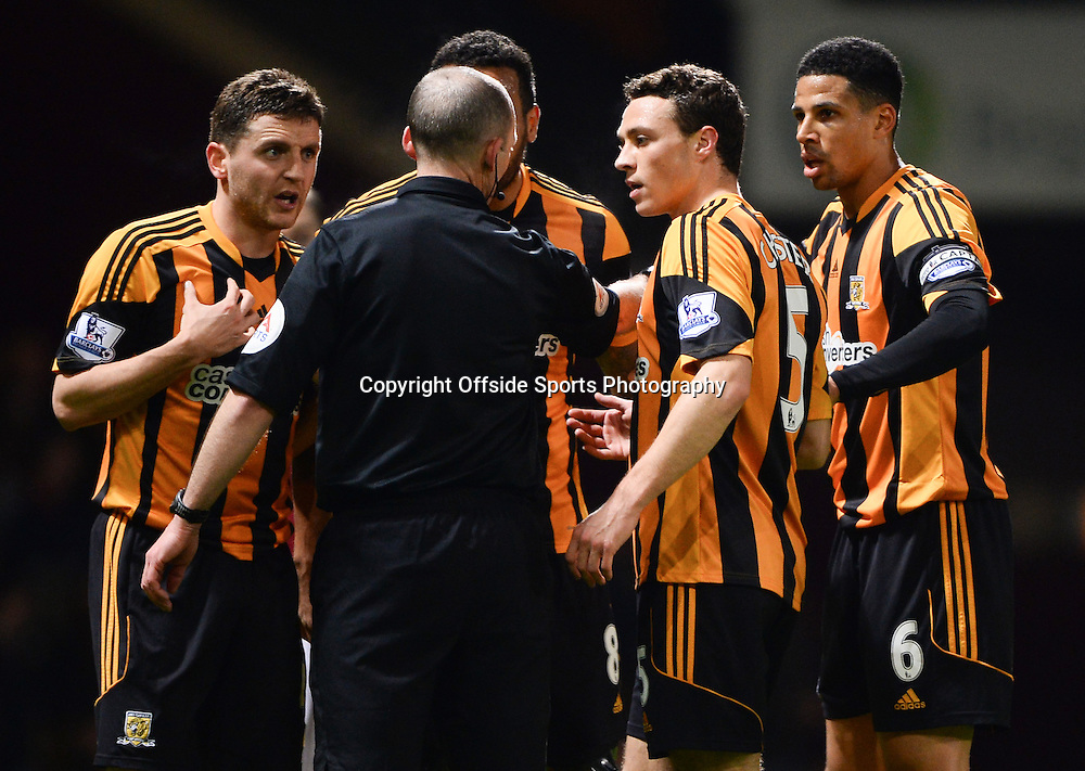 26 March 2014 - Barclays Premier League - West Ham United v Hull City - Hull players argue with Referee, Mike Dean as Allan Mcgregor is sent off - Photo: Marc Atkins / Offside.