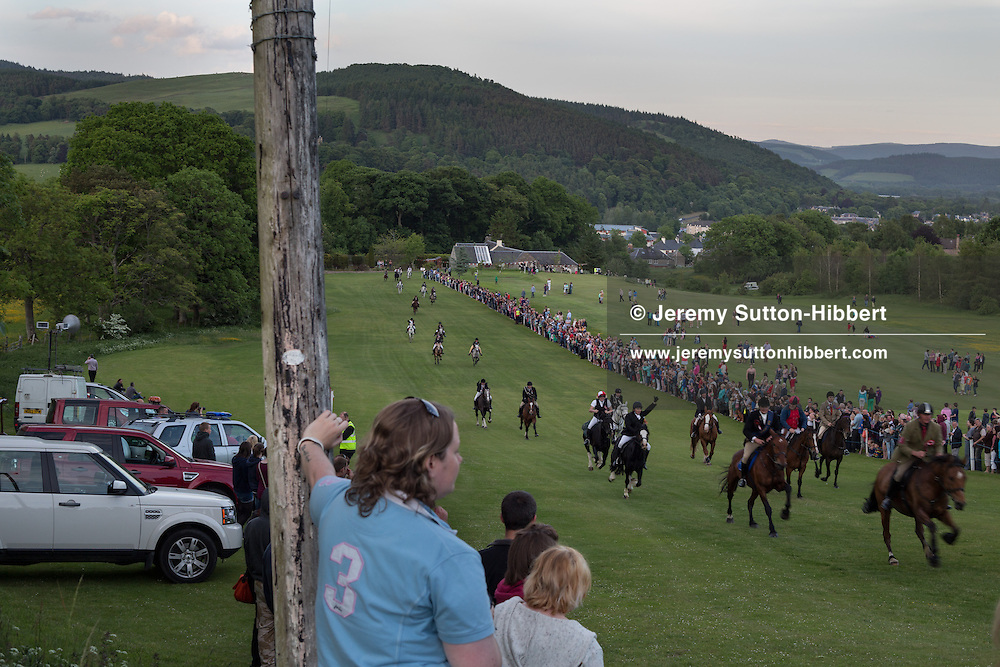 Horse racing, including the Beltane Bell race, on the golf course, at The Peebles Beltane Festival, including their Common Riding of the Marches, with Cornet Daniel Williamson, and Cornets Elect Lass Susan Thomson, in Peebles, Scotland, Wednesday 19th June 2013. <br /> N55&deg;39.574'<br /> W3&deg;12.563'