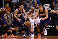 Feb 10, 2016; Phoenix, AZ, USA; Golden State Warriors center Marreese Speights (5) reaches for the ball in-between Phoenix Suns guard Devin Booker (1) and center Alex Len (21) at Talking Stick Resort Arena. The Golden State Warriors won 112-104. Mandatory Credit: Jennifer Stewart-USA TODAY Sports