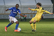 Hakeem Odoffinbttles with Southport FC Midfielder Jordan Lussey during the Vanarama National League match between Southport and Eastleigh at the Merseyrail Community Stadium, Southport, United Kingdom on 17 December 2016. Photo by Pete Burns.
