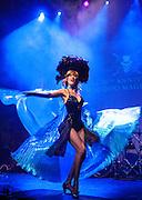 Trixie Minx of Fleur de Tease Burlesque Revue performs at the IAS Voodoo Magic Bash at the House of Blues