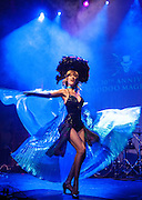 Trixie Minx of Fleur de Tease Burlesque Revue performs at the IAS Voodoo Magic Bash at the House of Blues