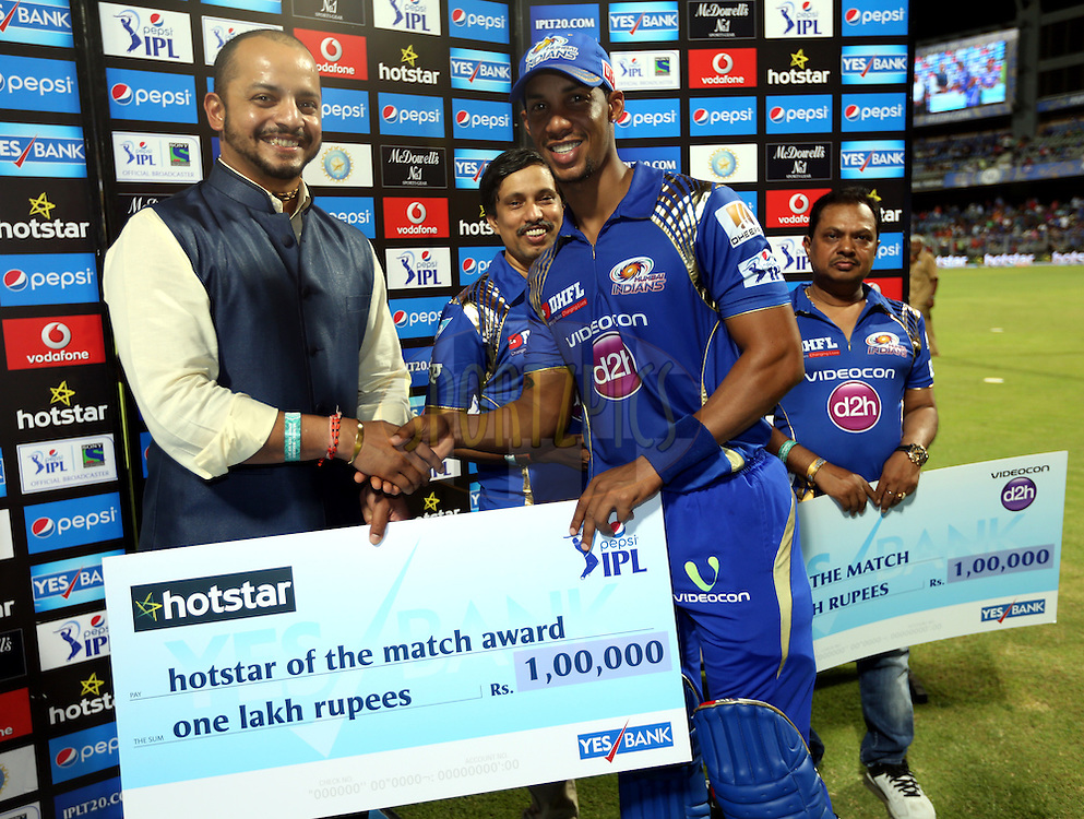 Mumbai Indians player Lendl Simmons player receives Hotstar of the match award during the presentation of the match 46 of the Pepsi IPL 2015 (Indian Premier League) between The Mumbai Indians and The Royal Challengers Bangalore held at the Wankhede Stadium in Mumbai, India on the 10th May 2015.<br /> <br /> Photo by:  Sandeep Shetty / SPORTZPICS / IPL
