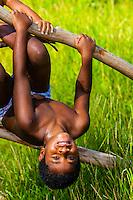 Kanak (Melanesian) boys playing, Lekiny, Island of Ouvea, Loyalty Islands, New Caledonia