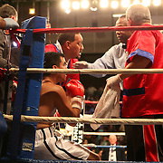 """Former WBO World champion Alex """"El Nene"""" Sanchez (White Trunks) of Ponce, Puerto Rico holds his left wrist during his  fight with Glen Donaire of the Philippines in a bout scheduled for 12 Rounds with the WBC Latin Flyweight Title on the line at the Kissimmee Civic Center in Kissimmee, Florida, on Friday, Dec 9, 2011.  Donaire won the bout when Sanchez  failed to come out in the ninth round. (AP Photo/Alex Menendez)"""
