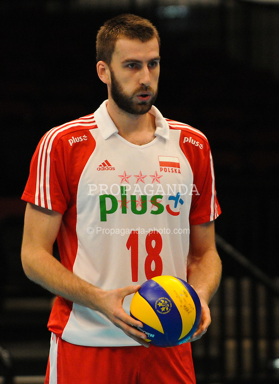 17.09.2011, Stadthalle, Wien, AUT, CEV, Europaeische Volleyball Meisterschaft 2011, Halbfinale, Italien vs Polen, im Bild Marcin Mozdzonek, (POL, #18, Middle-Blocker) // during the european Volleyball Championship Semi Final Italy vs Poland, at Stadthalle, Vienna, 2011-09-17, EXPA Pictures © 2011, PhotoCredit: EXPA/ M. Gruber