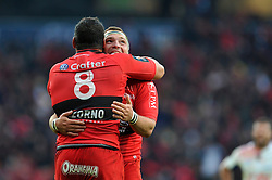 Alexandre Menini of Toulon embraces team-mate Chris Masoe after the match  - Photo mandatory by-line: Patrick Khachfe/JMP - Mobile: 07966 386802 02/05/2015 - SPORT - RUGBY UNION - London - Twickenham Stadium - ASM Clermont Auvergne v RC Toulon - European Rugby Champions Cup Final
