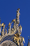 Detailed shot of gilded figures found on top of St. Mark's Basilica (Basilica di San Marco in Venezia), the most famous of the churches of Venice, Italy. The structure is one of the best examples of Byzantine architecture in the world. The building was also nicknamed Chiesa d'Oro ( church of gold ) due to it's lavish design and gilded Byzantine mosaics. The church dates back to 828 A.D and the basilica was consecrated in 1094 A.D...Subject photograph(s) are copyright Edward McCain. All rights are reserved except those specifically granted by Edward McCain in writing prior to publication...McCain Photography.211 S 4th Avenue.Tucson, AZ 85701-2103.(520) 623-1998.mobile: (520) 990-0999.fax: (520) 623-1190.http://www.mccainphoto.com.edward@mccainphoto.com.