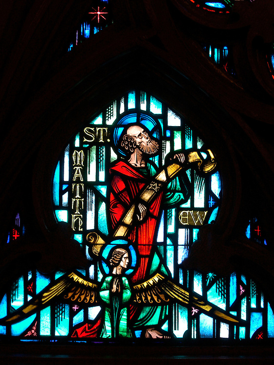 ST. MATTHEW -- A stained glass image of St. Matthew is pictured above the front entry of Gesu Church on the Marquette University campus in Milwaukee. (Photo by Sam Lucero)