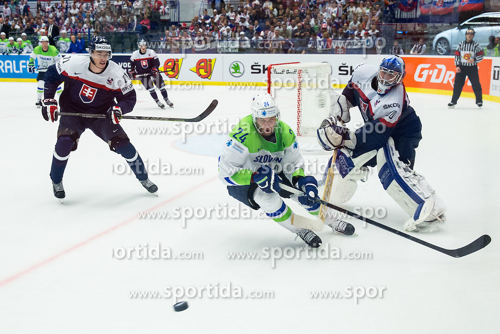 Rok Ticar of Slovenia vs Jan Laco of Slovakia during Ice Hockey match between Slovakia and Slovenia at Day 5 in Group B of 2015 IIHF World Championship, on May 5, 2015 in CEZ Arena, Ostrava, Czech Republic. Photo by Vid Ponikvar / Sportida