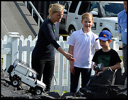 Countess of Wessex playing with remote controlled land rovers with her son James, Viscount Severn and her daughter Lady Louise Windsor at the Royal Windsor Horse Show. Windsor, United Kingdom. Wednesday, 14th May 2014. Picture by Andrew Parsons / i-Images