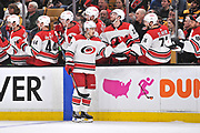 BOSTON, MA - MAY 09: Carolina Hurricanes center Sebastian Aho (20) gives fist bumps to the bench after his line scores a goal. During Game 1 of the Eastern Conference Finals featuring the Carolina Hurricanes against the Boston Bruins on May 09, 2019 at TD Garden in Boston, MA. (Photo by Michael Tureski/Icon Sportswire)