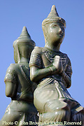 A dual Buddha statue rests atop a memorial to the deceased at a temple complex in Chiang Mai, Thailand.