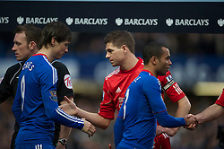 LONDON, ENGLAND - Sunday, February 6, 2011: Liverpool's captain Steven Gerrard MBE shakes hands with Chelsea's Fernando Torres before the Premiership match at Stamford Bridge. (Photo by David Rawcliffe/Propaganda)