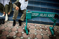Sharia Police, or the morality police, go to pray at a mosque in Banda Aceh, Indonesia, on Wednesday, Nov. 11, 2009. Banda Aceh enforces a moderate form of Islamic Law.