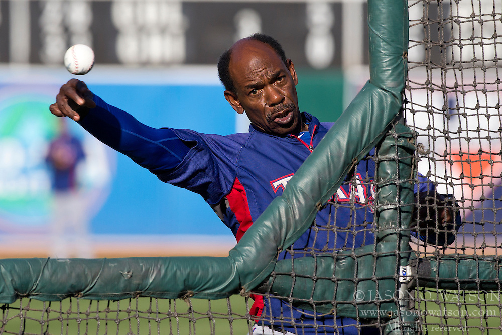 OAKLAND, CA - MAY 14:  Ron Washington #38 of the Texas Rangers pitches during batting practice before the game against the Oakland Athletics at O.co Coliseum on May 14, 2013 in Oakland, California. (Photo by Jason O. Watson/Getty Images) *** Local Caption *** Ron Washington