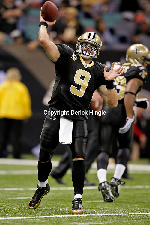Nov 08, 2009; New Orleans, LA, USA;  New Orleans Saints quarterback Drew Brees (9) throws in warm ups prior to kickoff against the Carolina Panthers at the Louisiana Superdome. The Saints defeated the Panthers 30-20. Mandatory Credit: Derick E. Hingle