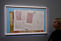 "© Licensed to London News Pictures. 17/11/2017. London, UK.  London, UK.  17 November 2017. A staff member views ""Sept 58 (Iseo)"", 1958, by Ben Nicholson (Est. GBP 400-600k). Preview upcoming auctions of Modern & Post War British Art and Scottish Art taking place at Sotheby's, New Bond Street, on 21 and 22 November. Photo credit: Stephen Chung/LNP"