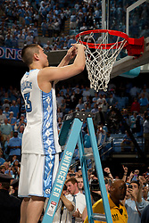 CHAPEL HILL, NC - MARCH 05: Daniel Bolick #3 of the North Carolina Tar Heels cuts down the net after defeating the Duke Blue Devils and winning the regular season ACC championship on March 05, 2011 at the Dean E. Smith Center in Chapel Hill, North Carolina. North Carolina won 67-81. (Photo by Peyton Williams/UNC/Getty Images) *** Local Caption *** Daniel Bolick