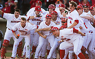 The Nebraska Cornhuskers wait at home base for Steven Reveles (5) who heads home after hitting a walk-off home run during Nebraska's 6-4 win over Loyola Marymount University at Haymarket Park in Lincoln, Neb., on March 11, 2016. Photo by Aaron Babcock, Hail Varsity