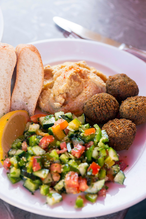 FEZ, MOROCCO - 1st DECEMBER 2016 - Falafel, hummus and Moroccan salad dish at a restaurant in Fez, Morocco.