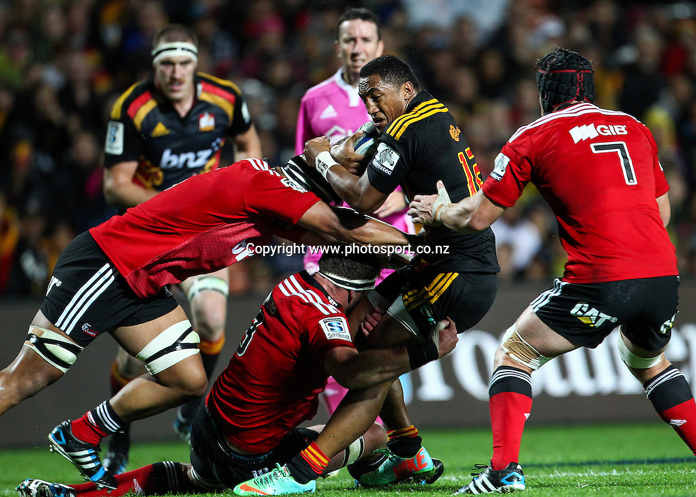 Chiefs' Bundee Aki is caught in big Crusaders defense during the Super 15 Rugby match - Chiefs v Crusaders at Waikato Stadium, Hamilton, New Zealand on Saturday 19 April 2014.  Photo:  Bruce Lim / www.photosport.co.nz