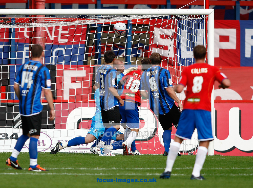 Picture by Andrew Tobin/Focus Images Ltd. 07710 761829.. 3/9/11 Danny Hylton (10) of Aldershot scores their first goal during the Npower League 2  match between Aldershot and Cheltenham Town at the EBB Stadium, Aldershot, Hampshire