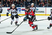 KELOWNA, BC - DECEMBER 18:  Matthew Wedman #20 of the Kelowna Rockets skates with the puck while being checked by the Vancouver Giants at Prospera Place on December 18, 2019 in Kelowna, Canada. (Photo by Marissa Baecker/Shoot the Breeze)