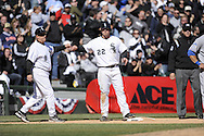 CHICAGO - APRIL 07:  Josh Fields #22 of the Chicago White Sox is congratulated at third base by White Sox coach Jeff Cox #6 after reaching third base against the Kansas City Royals on April 7, 2009 at U.S. Cellular Field in Chicago, Illinois.  The White Sox defeated the Royals 4-2.  (Photo by Ron Vesely)