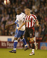 Photo: Aidan Ellis.<br /> Sheffield United v Middlesbrough. The Barclays Premiership. 30/09/2006.<br /> Sheffield's Phil jagielka and Boro's Yakubu