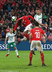 Switzerland's Manuel Akanji (left) heads the ball clear from danger under pressure from Northern Ireland's Gareth McAuley during the FIFA World Cup Qualifying second leg match at St Jakob Park, Basel.