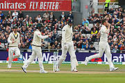 Wicket - Craig Overton of England looks dejected as he walks back to the pavilion after being dismissed by Josh Hazlewood of Australia during the International Test Match 2019, fourth test, day three match between England and Australia at Old Trafford, Manchester, England on 6 September 2019.