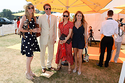 Left to right, ANNABEL SIMPSON, film director TOM HOOPER, EMILIA HUNGERFORD and the HON.ELIZA PEARSON at the Veuve Clicquot Gold Cup, Cowdray Park, Midhurst, West Sussex on 21st July 2013.
