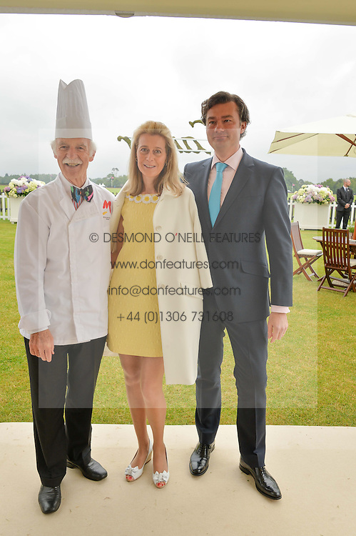 Left to right, ANTON MOSIMANN and LAURENT & CARINE FENIOU at the Cartier Queen's Cup Polo final at Guard's Polo Club, Smiths Lawn, Windsor Great Park, Egham, Surrey on 14th June 2015