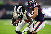HOUSTON, TX - AUGUST 29:  Nsimba Webster #14 of the Los Angeles Rams is tackled by Xavier Crawford #28 of the Houston Texans during week four of the preseason at NRG Stadium on August 29, 2019 in Houston, Texas. The Rams defeated the Texans 22-10.   (Photo by Wesley Hitt/Getty Images) *** Local Caption *** Nsimba Webster; Xavier Crawford