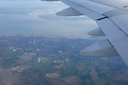 From the window seat of an Airbus A319, the runway of Southend Airport below in Essex, on 26th March 2017, England.
