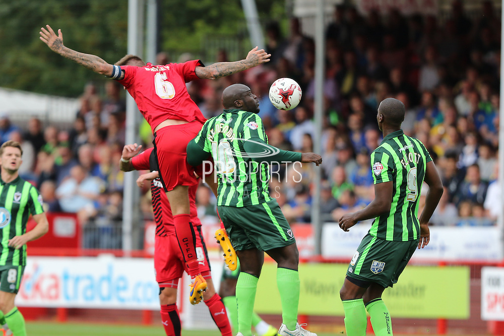 Bayo Akinfenwa of AFC Wimbledon Sonny Bradley (Capatin) during the Sky Bet League 2 match between Crawley Town and AFC Wimbledon at the Checkatrade.com Stadium, Crawley, England on 15 August 2015. Photo by Stuart Butcher.