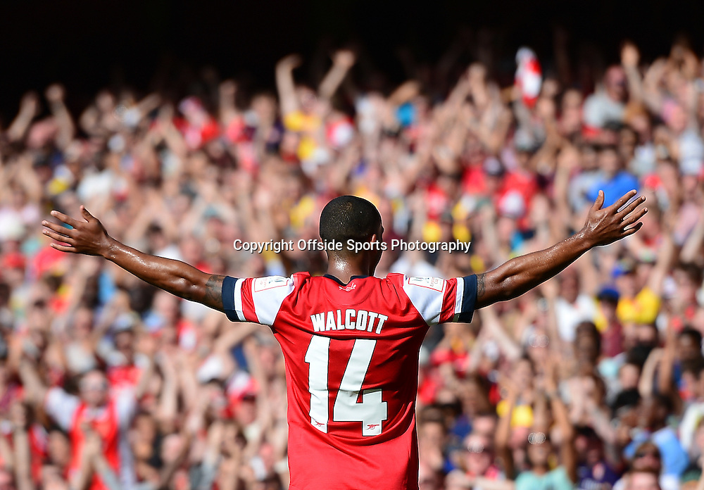4th August 2013 - Emirates Cup - Arsenal v Galatasary - Theo Walcott of Arsenal celebrates scoring the opening goal in front of the fans  - Photo: Marc Atkins / Offside.