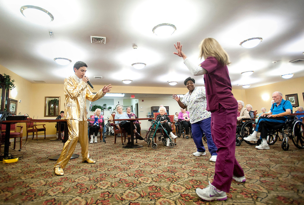 Taylor Rodriguez gets the crowd to their feet at Heritage Green Assisted Living in Lynchburg.