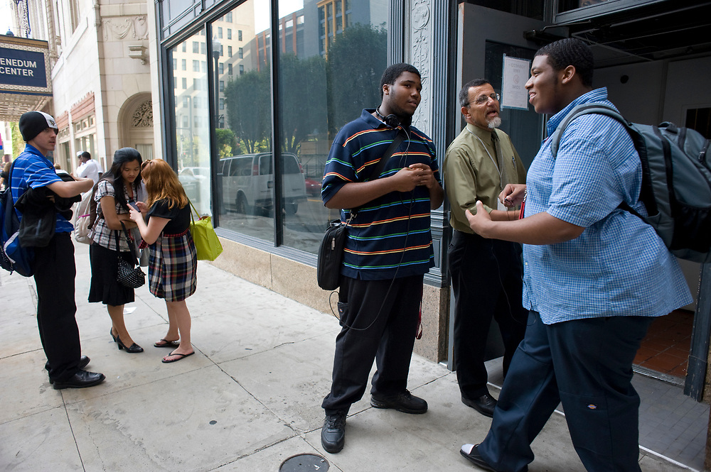 Principal Dr. Jim Wertheimer (center) talks with City Charter High School students Maurice Dewberry and Larry Hailsham (right) during dismissal on 7th Street in downtown Pittsburgh. Nearly 600 students attend City High.