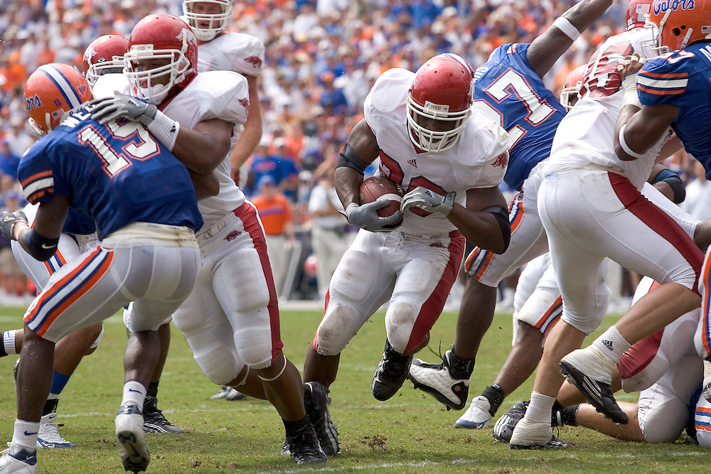 Arkansas Razorback running back DeArrius Howard runs through the line for a touchdown during a 45 to 30 loss to the Florida Gators on October 2, 2004 at Ben Hill Griffin Stadium in Gainesville, Florida.
