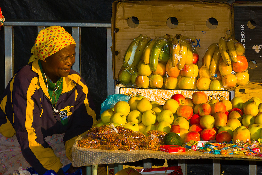 A woman selling fruit in Soweto (formerly 38 townships, the South Western Townships were renamed Soweto in 1963),  Johannesburg, South Africa
