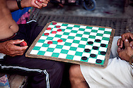 Men playing checkers in Holguin, Cuba.